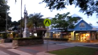 Walking up Macrossan Street in Port Douglas at dawn toward Four Mile Beach