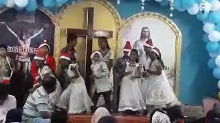 Sunday school children dancing for Jungle bells at HOLY CHURCH FOUNDATION,GUNTUR