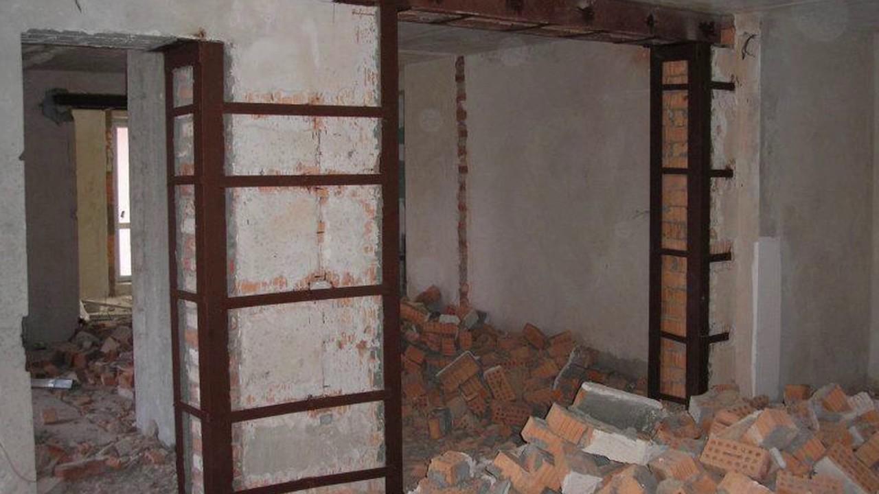 проход в несущей стене кирпичного дома