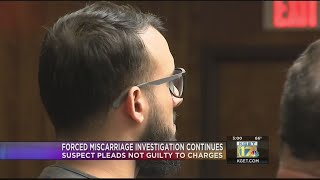 Man accused of forcing ex-girlfriend's miscarriage at gunpoint pleads not guilty