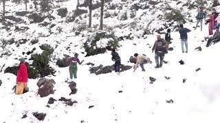 J&K: Tourists enjoy snowfall in Udhampur