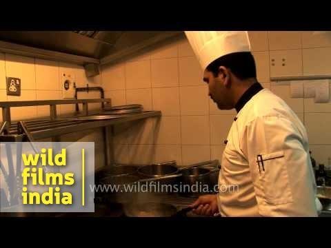 Chef cooks at a restaurant in Mysore, Karnataka