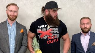 Braun Strowman bites into a whole pineapple