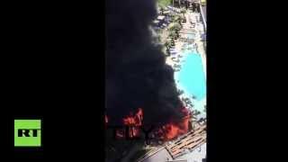 Fire rages at Cosmopolitan hotel, huge plumes of black smoke fill Las Vegas skyline