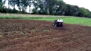Food plots with the ATV. Using the old drag to flatten out the plot.  It's so easy a child can do it