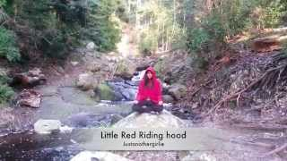 Little red riding hood meditating in forest Thumbnail
