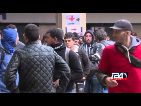 Migrants speak to i24news after arriving in Vienna from Hungary