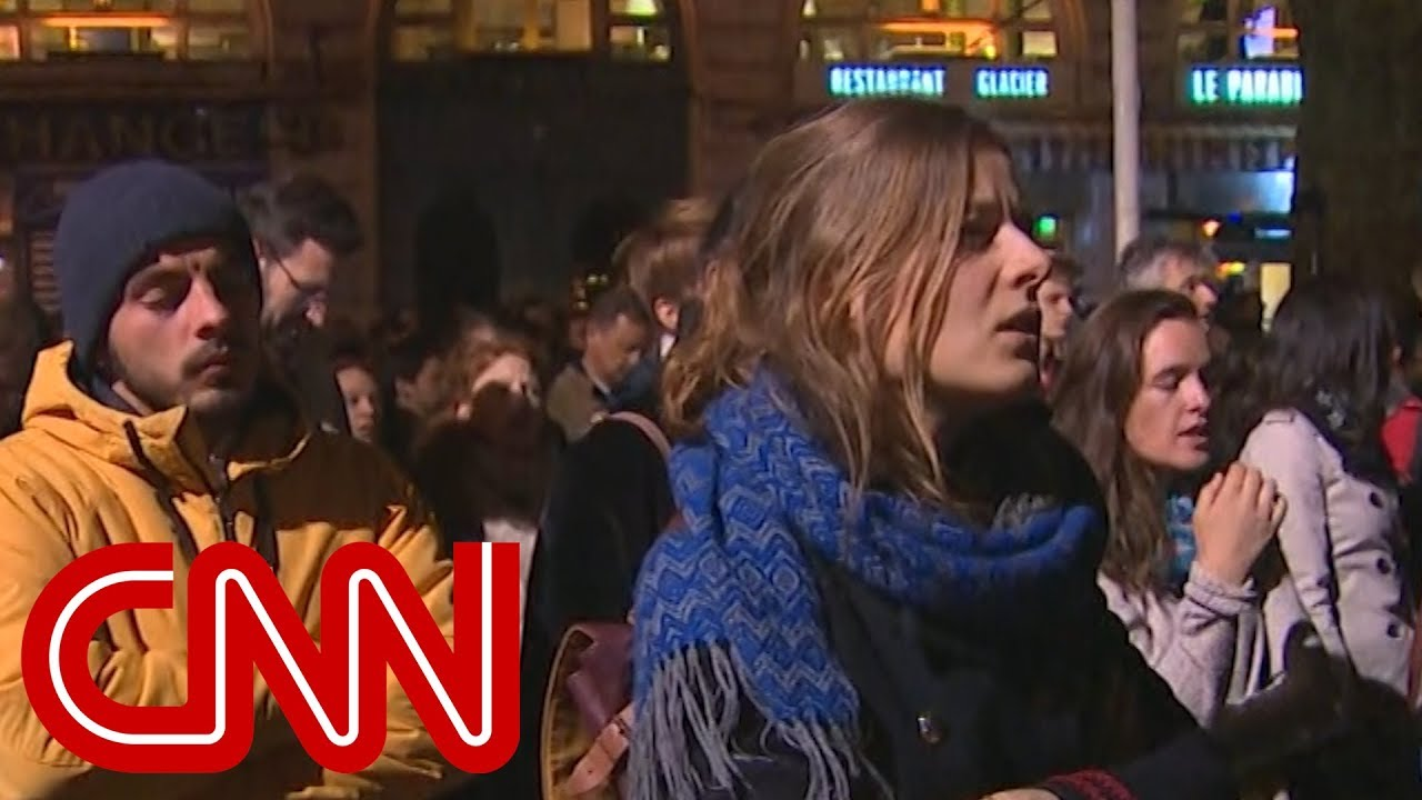 Hear crowds sing hymns outside Notre Dame