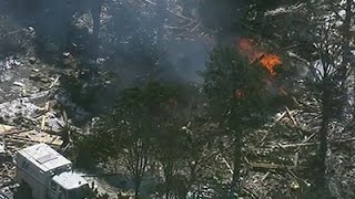 Raw: Natural Gas Blast Destroys Home, Injures 3
