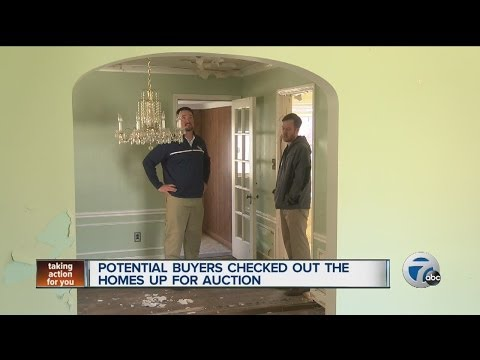 Potential buyers check out Detroit homes up for auction