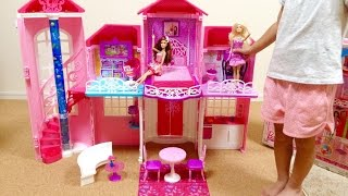 We were playing in the big house of Barbie dolls. Barbie just loves...
