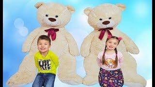 Richard and Dominika pretend play with Giant Teddy bears