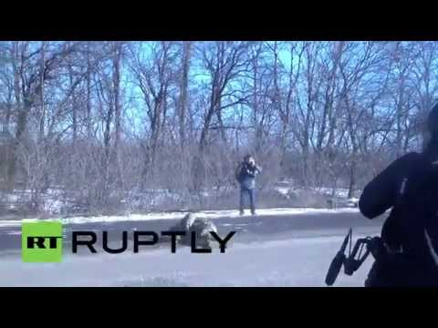 Ukraine: See war-shattered Kiev soldier COLLAPSE off moving IFV in Debaltsevo