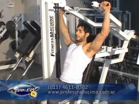 Ejercicio press de hombros en m quina de musculaci n for Maquinas de ejercicios