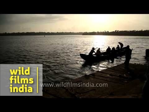 Local people cross Ashtamudi Lake by boat - Kollam