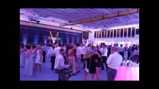 Marshall School gym in pink wedding lighting by Duluth Event Lighting
