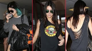 Kendall Jenner Exposes Back While Catching Plane With Kylie, Stays Mum On Kimye Wedding  [2014]