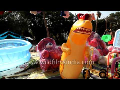 Vendors sell plastic toys at street market, New Delhi
