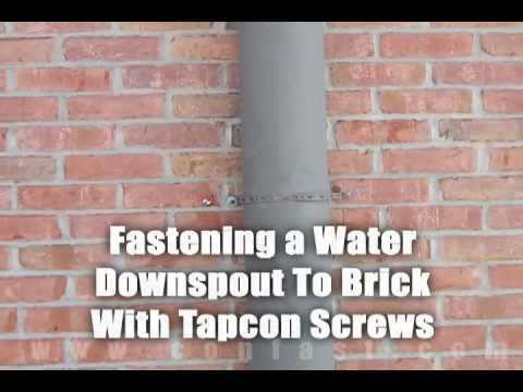 Water Downspout Fastened To Brick Using Tapcon Brick