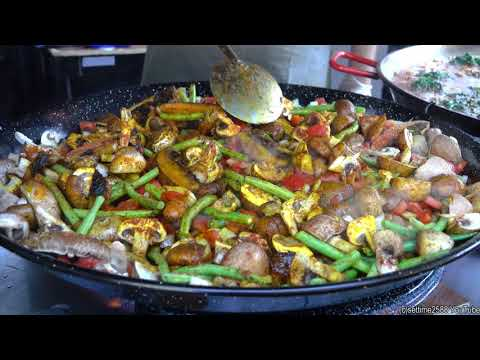Cooking Spanish Paella with Vegetables and Mushrooms. London Street Food