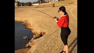 Paul George teaches his girlfriend how to fish