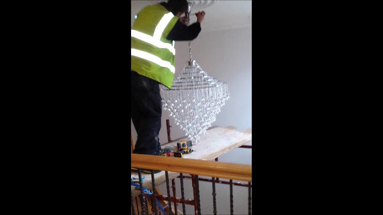 How to install a large chandelier in a high ceiling by integrated how to install a large chandelier in a high ceiling by integrated electricians london youtube mozeypictures