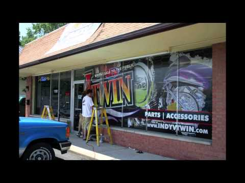 Hygh Octane Graphics installing window graphics on storefront