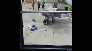 Catering truck loses control at O'hare and plane flies between buildings.