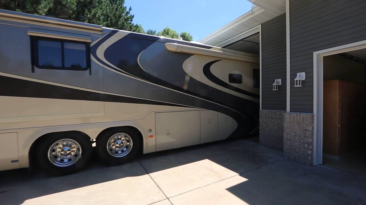 Executive rambler with class a rv garage youtube for Custom rv garages