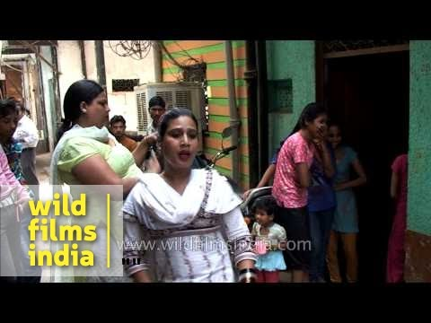 Indian transgenders or hijras dance at home of new-born baby
