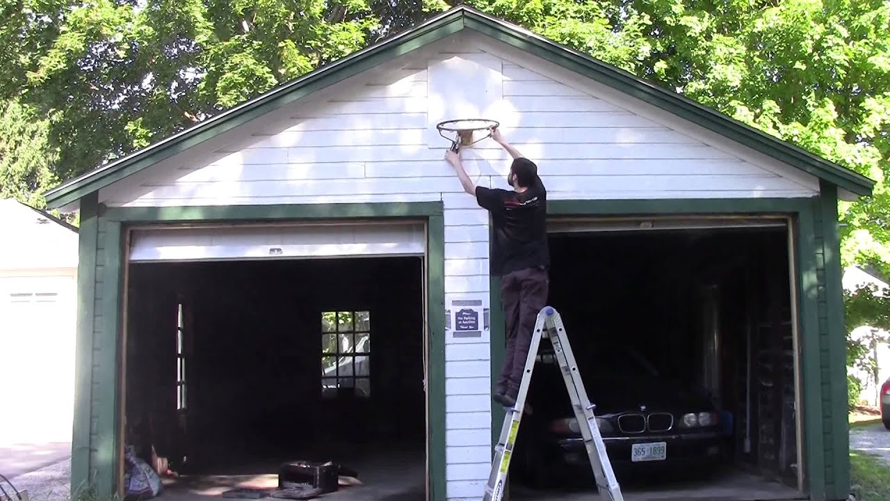 Steve removes basketball net from kac garage youtube for Basketball garage