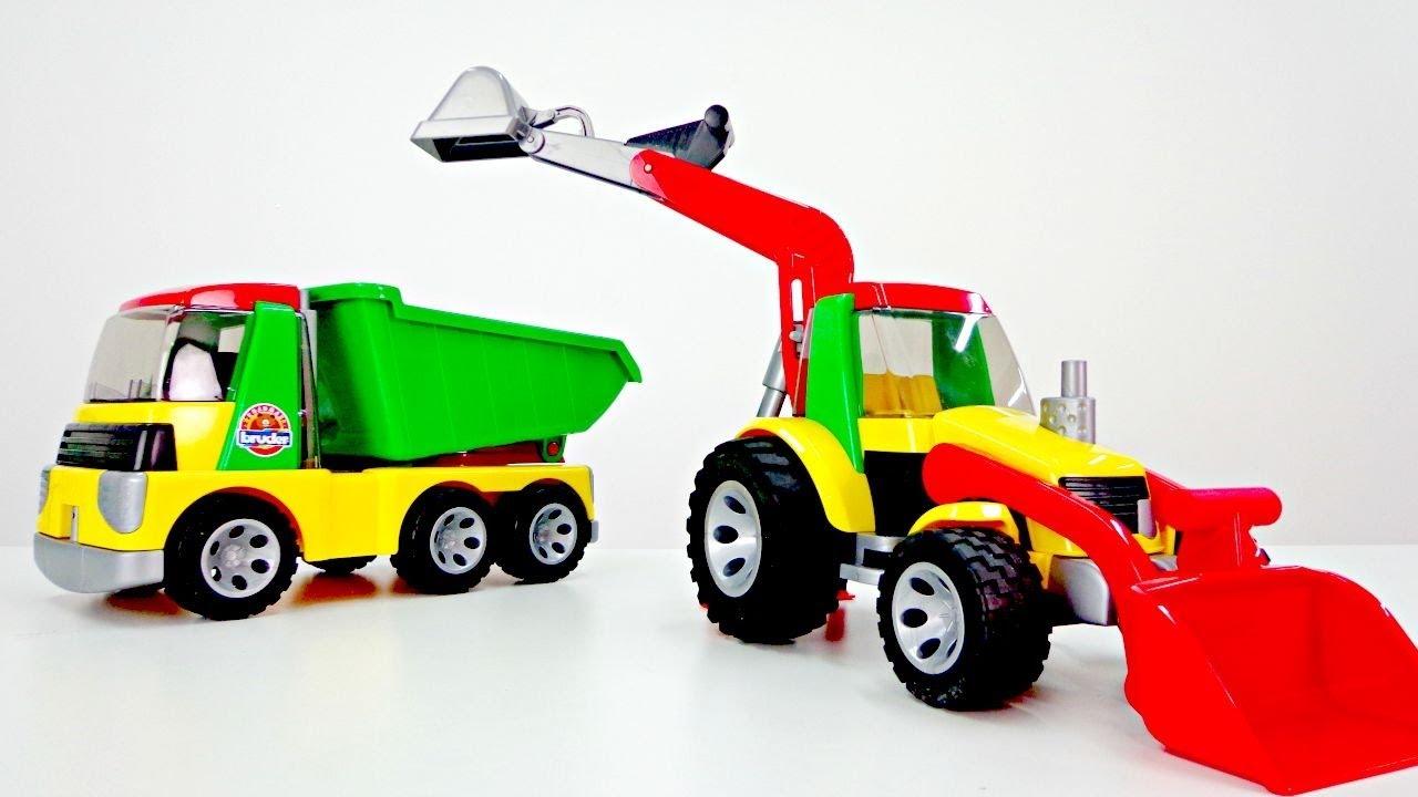 Tolle spielsachen wir packen spielzeug aus der traktor