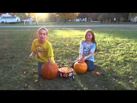 Kids cleaning out their pumpkins