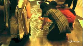 Making of a Pookalam (Athapookalam) (Flower Carpet)