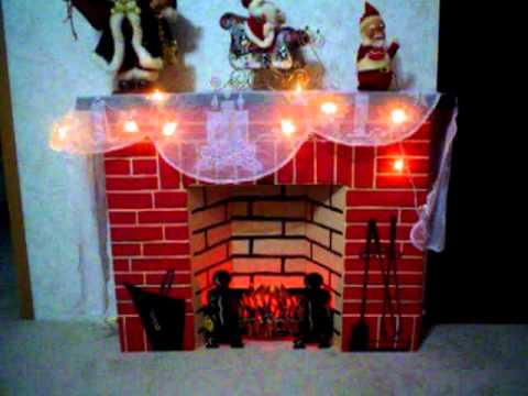 This is a vintage cardboard Christmas fireplace.