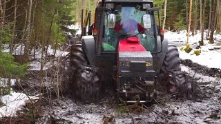 Valtra forestry tractor in wet forest (in peat bog)