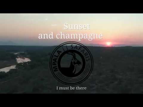 Beautiful sunset and champagne in Karen Blixen like safari