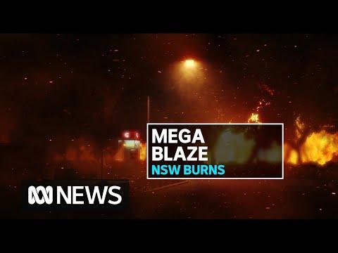 Bushfires combine to create 60km 'mega fire' north of Sydney | ABC News