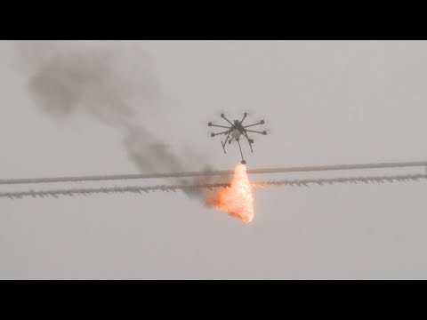 Drones used to remove ice from wires in southwest China