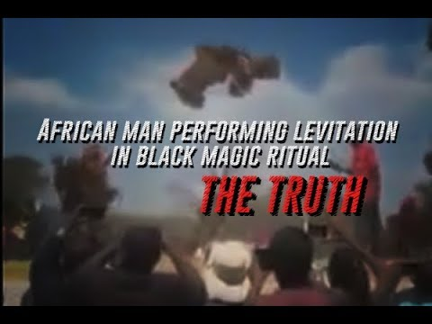 African man performing levitation in black magic ritual. THE
