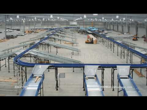 Parcel conveyer system being installed into empty warehouse