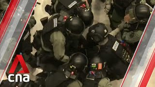 Hong Kong protests: Protesters gather in malls; scuffles break out with riot police