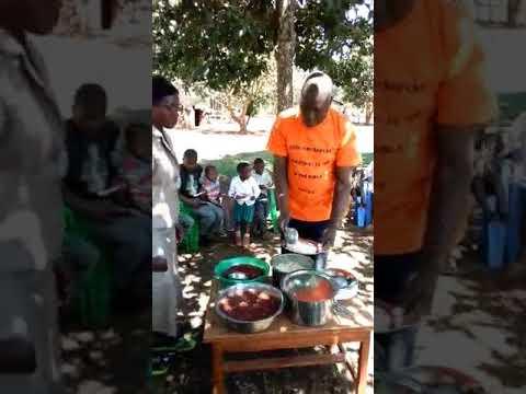 Haron and Brethren Feeding Children GMFC Western Kenya