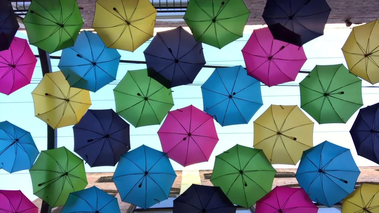 Redlands\' Orange Street alley adorned with colorful umbrellas - YouTube
