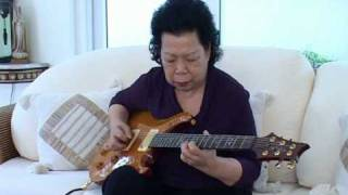 I Need Your Love So Bad -- My Grandmother Playing the Guitar