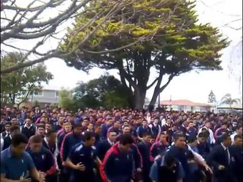Kelston Boys' High School perform a massive haka in honour of the new Maori carving on campus.
