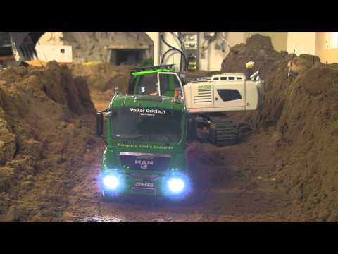 Big RC Excavator loading dump trucks