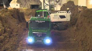 Big RC Excavator loading dump trucks