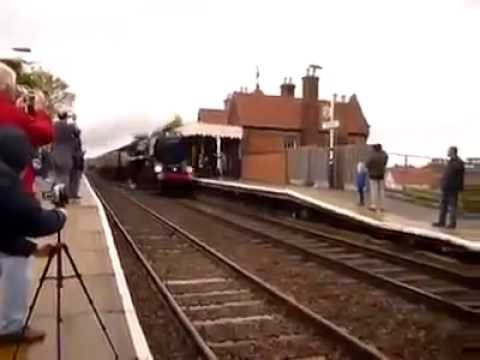 A photographer who is almost hit by a train