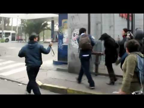 Allende followers attack defenseless woman in Santiago, Chile.mp4